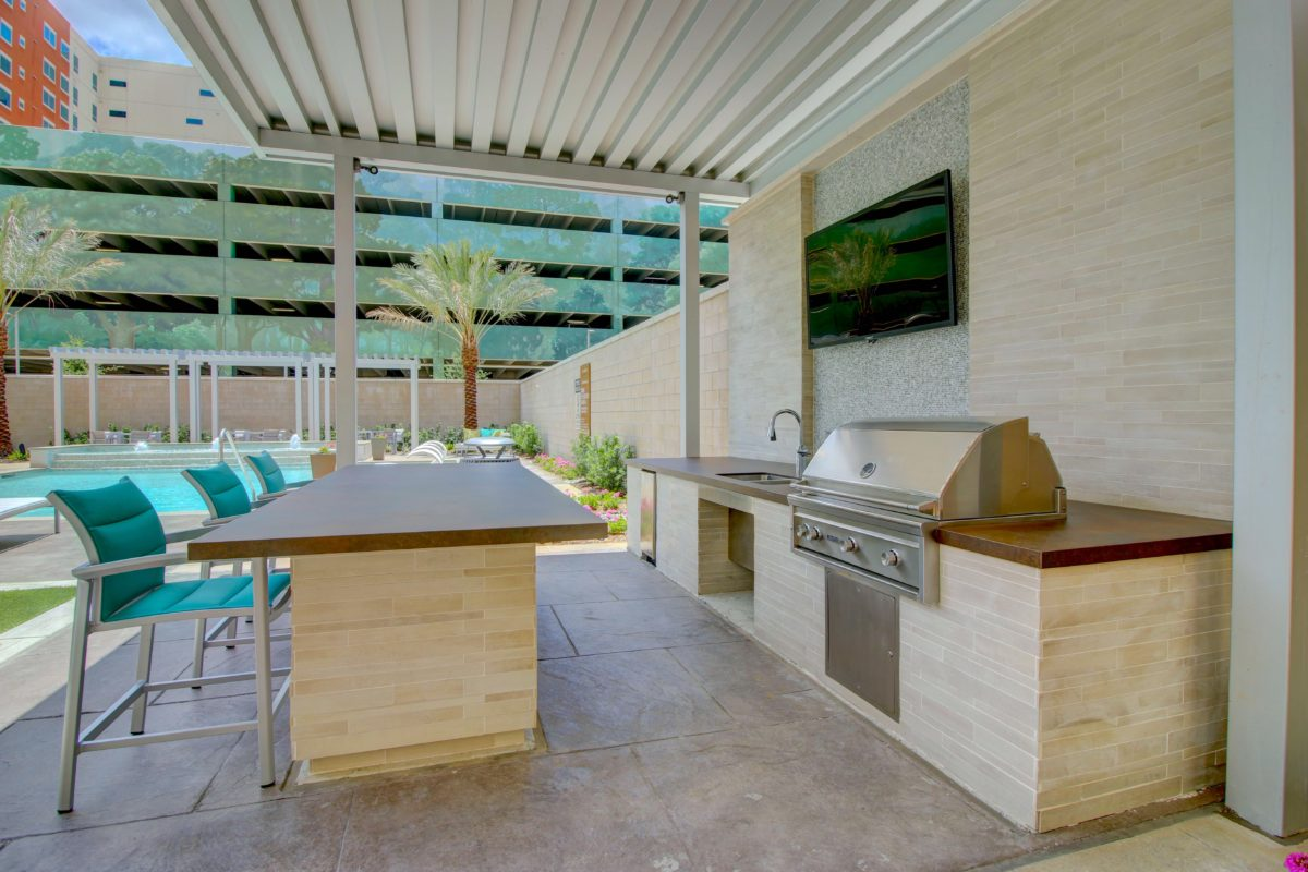 Covered grilling station and built in kitchen at The McCarthy Houston