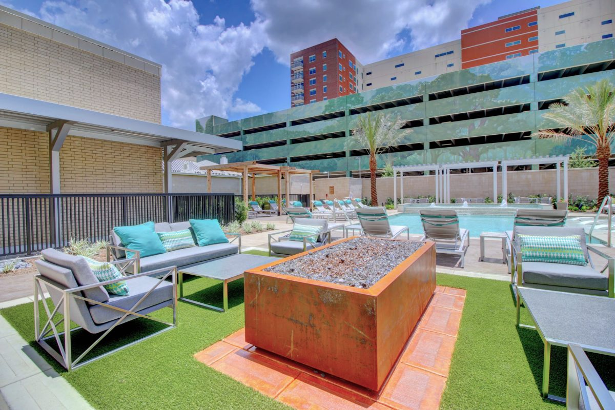 Outdoor lounge by the pool at The McCarthy Houston